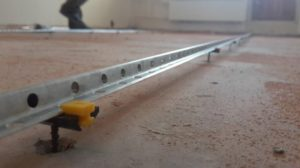 Виды направляющих для бетонного пола